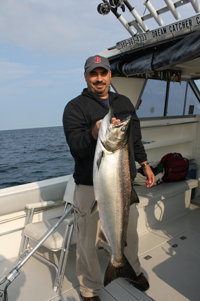 Lake ontario king salmon trout charters fins and furs for Salmon fishing lake ontario